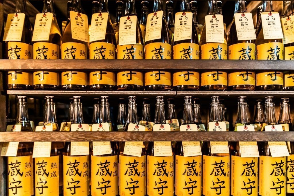 Traditional sake (rice wine) bottles displayed at an Izakaya bar in Tokyo